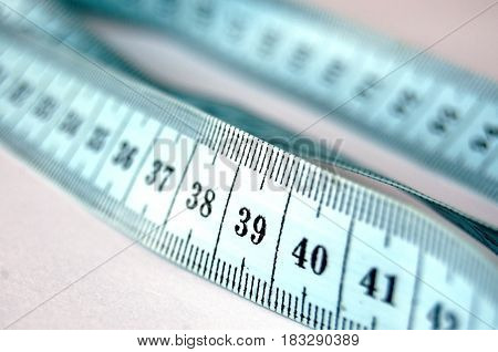 Measuring meter for tailor meter for sewing on light background. Selective focus