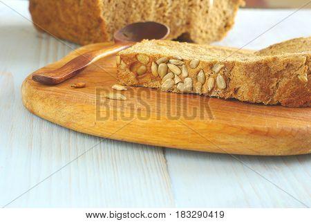 Bread slice organic natural homemade wholegrain healthy nutrition. Healthy dieting food ingredient. Selective focus crust piece. Rustical bread oldstyle eating. Tasty baker meal closeup.