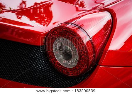 BERLIN - JUNE 14 2015: Stoplight of a sports car Ferrari 458 Spider (since 2011). The Classic Days on Kurfuerstendamm.