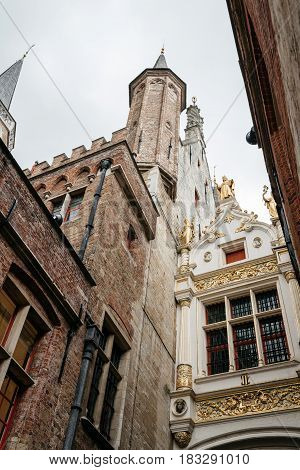 Bruges Belgium - July 29 2016: Low angle view of Town Hall Tower of Bruges. The historic city centre is a World Heritage Site of UNESCO. It is known for his picturesque cobbled lanes and dreamy canals