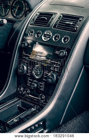 BERLIN - JUNE 14 2015: Fragment of the dashboard of a luxury sports car Aston Martin V8 Vantage N430 (since 2015). Toning. Stylization. The Classic Days on Kurfuerstendamm.