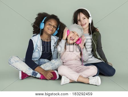 Group of Little Girls Studio Smiling Wearing Headphones and Winter Clothes
