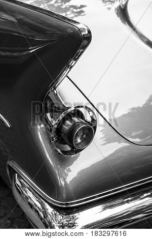 BERLIN - JUNE 14 2015: Stoplight of a luxury car Imperial Custom 4-door Southampton 1961. Black and white. The Classic Days on Kurfuerstendamm.