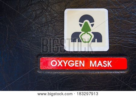 Oxygen mask warning label in an airliner cockpit. Used in emergency cases for supplying emergency oxygen supply.