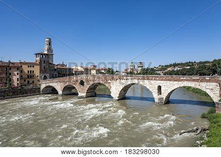 the old roman bridge in Verona spans the river Etsch