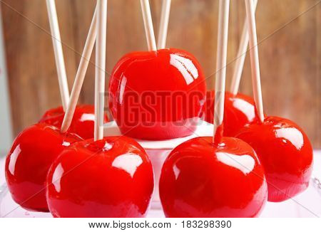 Delicious holiday apples on glass stand, closeup
