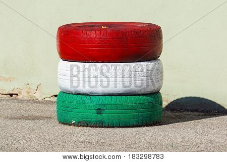 Tires turnovers . shock-proof tires with red and white green colors .
