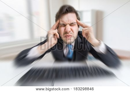 Young Overworked Man Is Tired By Working With Compuiter And Suff