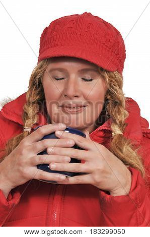 Older middle aged woman drinking and smelling coffee