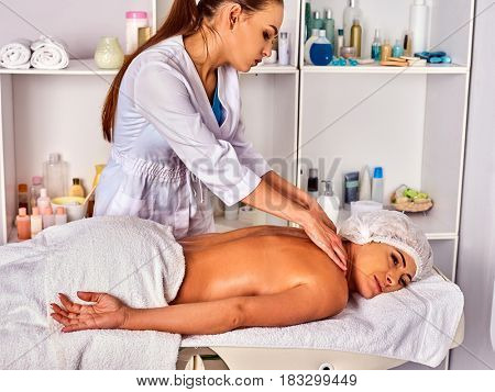 Massage room for therapy deals. Woman therapist making manual therapy neck and shoulders. Hands of masseuse treatment of spinal injuries 40 old mature client in spa salon.