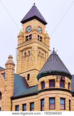Old City Hall Building with historic Victorian architectural style including a clock tower taken in Downtown Wichita, KS