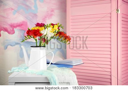 Composition with beautiful bouquet of freesia flowers indoors