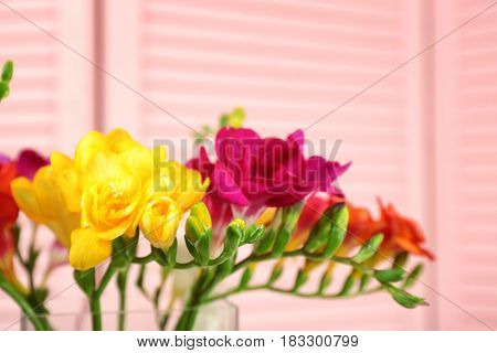 Beautiful bouquet of freesia flowers on blurred background, closeup