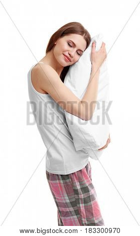 Young happy woman in pajamas hugging orthopedic pillow on light background. Healthy posture concept