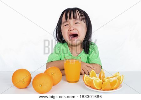 Asian Chinese Little Girl Crying For Orange Juice