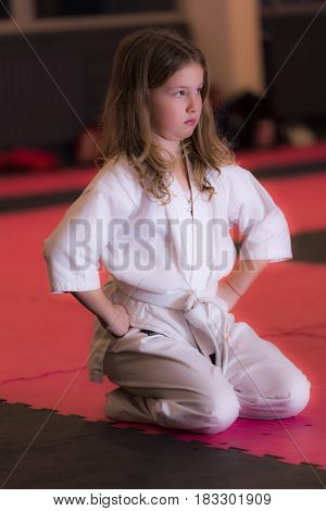Motivation, healthy young athletic girl ,in kimono, doing exercises, doing splits