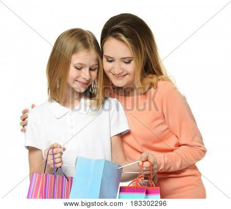 Mother and daughter with paper bags on white background