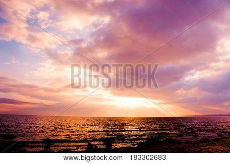 Fiery Backdrop Over Water