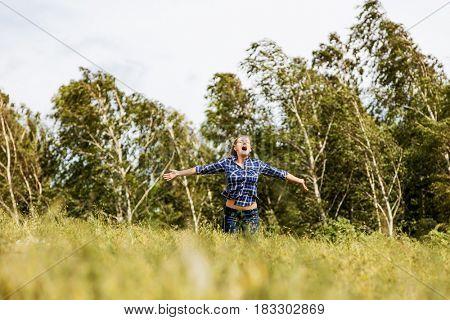 Woman in beautiful nature setting