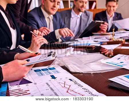 Business people office life of team people working with papers sitting table . Schemas and diagrams close up.