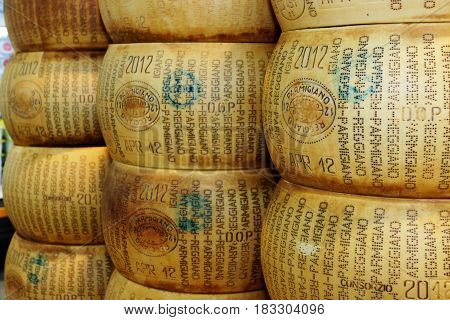 ROME, ITALY. March 26, 2014: Form of parmesan cheese inside a large supermarket (M.A. Supermarket) in Rome, Italy.