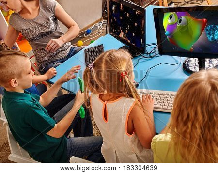 poster of Children computer class us for education and video game. Boys and girls in children's club who spend many hours behind computer monitor harmful to health. New technologies alternative to classical