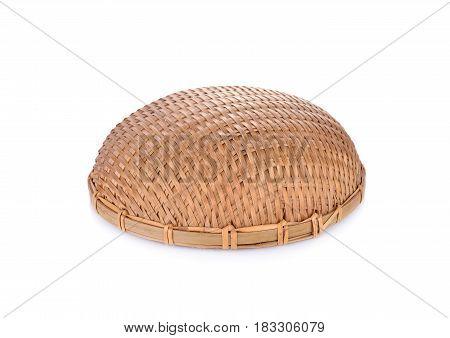 empty round bamboo basket on white background