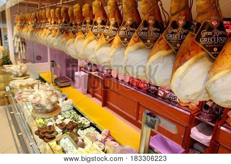 ROME, ITALY. March 26, 2014: Shelves with typical Italian sausages (prosciutto) inside a new market (M.A. Supermarket) opening in Rome, Italy.