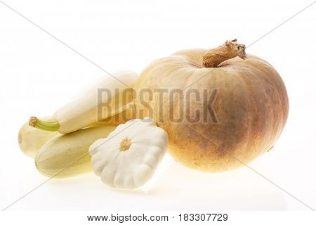 Fresh ripe pumpkin and vegetable marrows on a white background. Harvest.