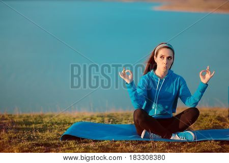 Funny Girl Meditating on Yoga Mat in Nature
