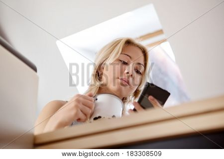 Teen girl using cell phone at home