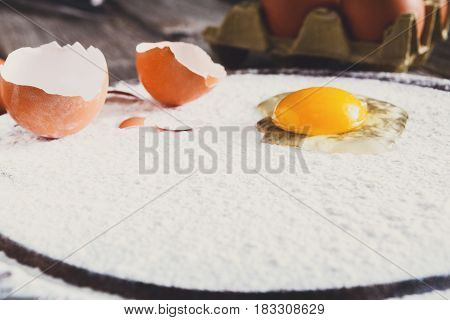 Baking concept. Flour and eggs on wood, cooking ingredients. Prepare for making yeast dough