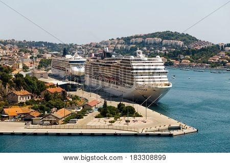 wo large liners stand in the Bay of Gruz in the international sea port in Dubrovnik, Croatia.