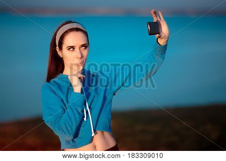 Cute Girl In Sportswear Outfit Taking a Selfie