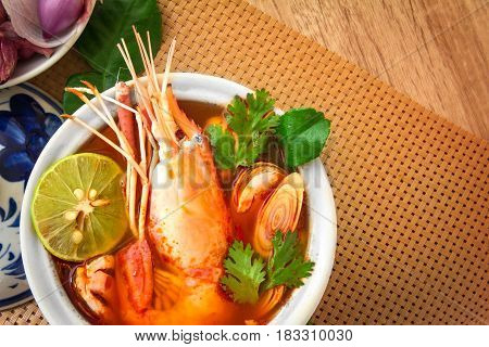 Closeup Asian Spicy soup with shrimp in bowl famous Thai food cuisine calling Tom Yum Kung