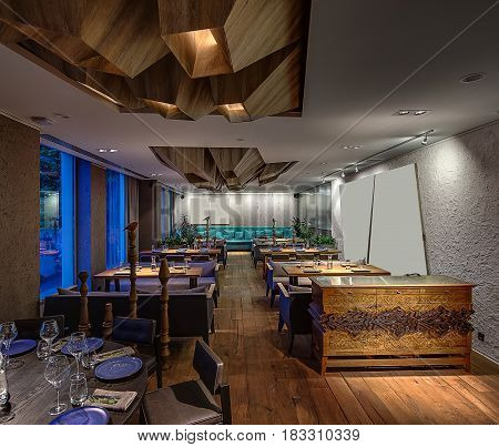 Luminous modern cafe with textured walls. There are sofas with pillows, tables, chairs, wooden poles with birds, plants, commode with ornament. On the ceiling there is wooden geometric construction.