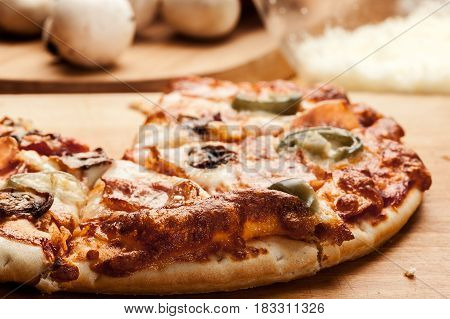 Slices Of Pizza With Bacon, Olives And Jalapeno Papper
