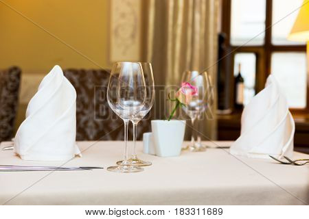Two glasses as table decoration. Table setting corporate