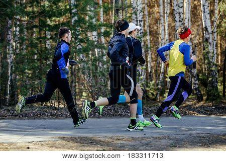 Chelyabinsk Russia - April 22 2017: group runners men running on asphalt road during Spring half marathon