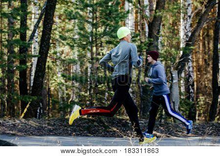 Chelyabinsk Russia - April 22 2017: two runners men running each other in Spring half marathon