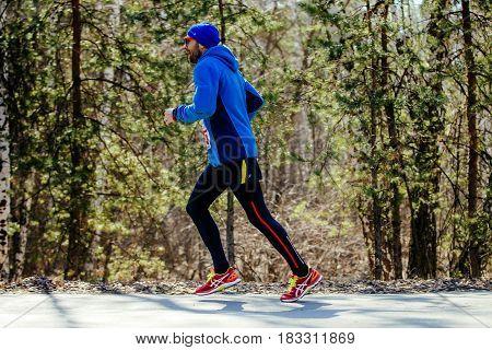 Chelyabinsk Russia - April 22 2017: bearded male runner running in city Park during Spring half marathon