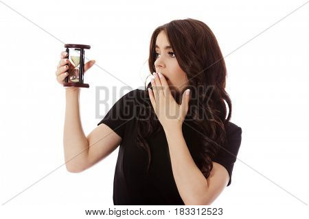 Young business woman with hourglass - time concept