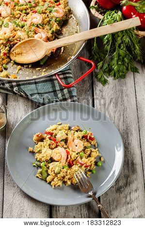 Traditional Seafood Paella With Shrimp, Fish And Chicken Seved I