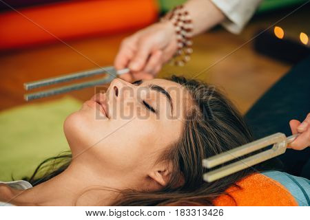 Tuning fork in sound therapy, color image