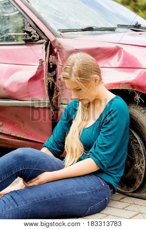 Upset driver woman in front of automobile crash car.