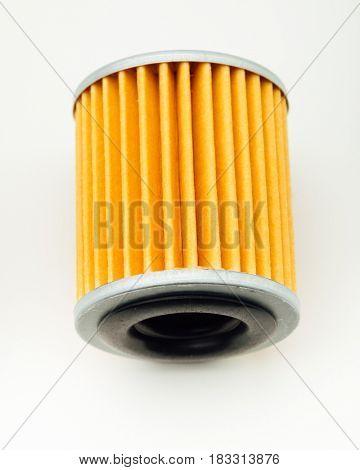 oil filter part for car, white background