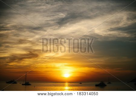Picturesque sunset on the Andaman sea. Seascape of Thailand. Vacation, resort, holiday