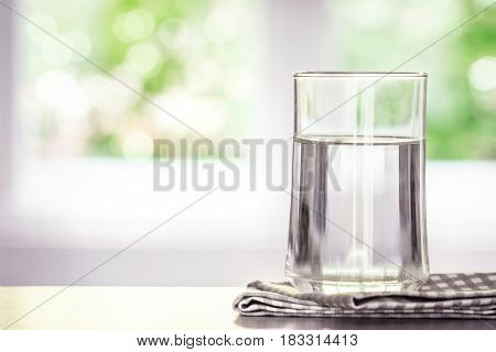Close up purified fresh drink water from the bottle on table in living room