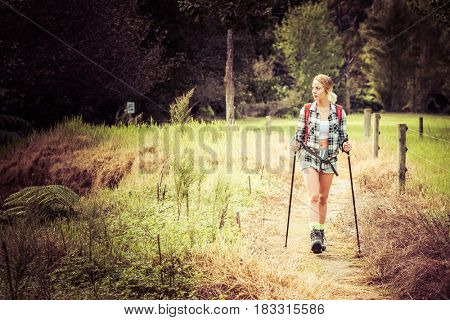 Young woman with hiking poles