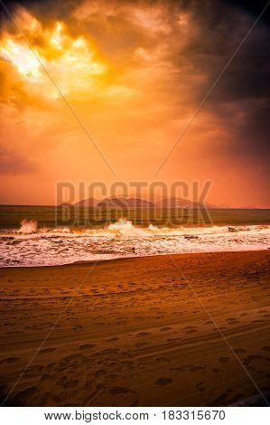 Nature in twilight period, Sunrise or Sunset over the sea with beach. Sea view from tropical beach with purple sky. Summer with blue sea water and purple sky. Vintage retro seascape